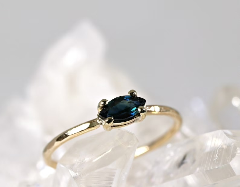 rich dark blue tilted marquise engagement ring