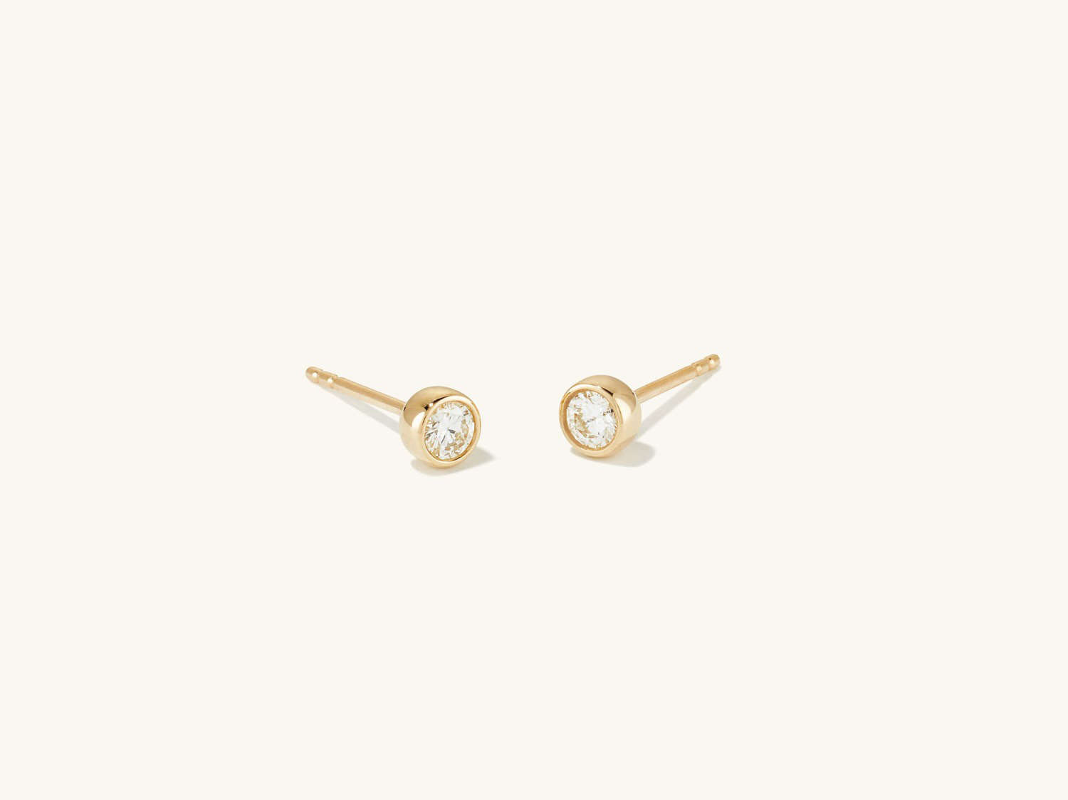 round cut diamond stud earrings with yellow gold posts