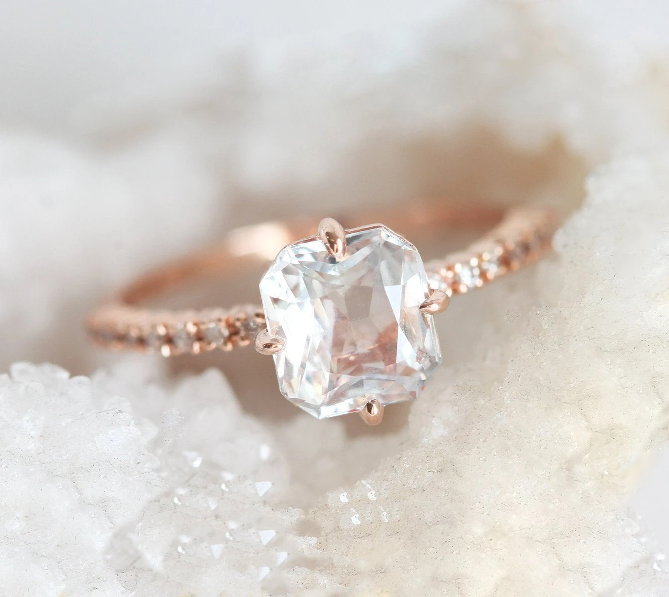 square shaped solitaire white sapphire with cut corners in a rose gold prong setting