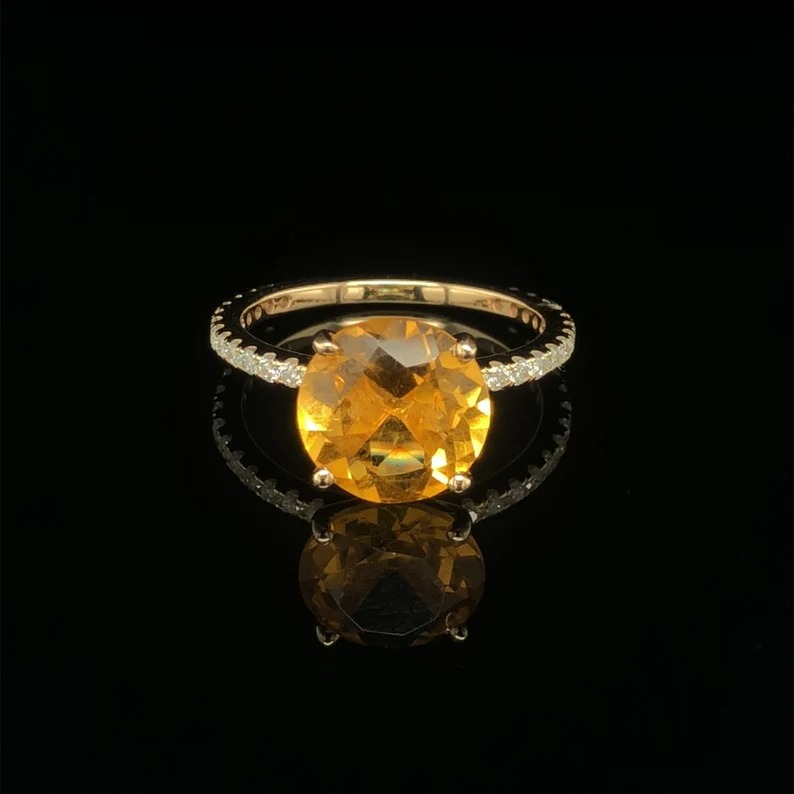 gold banded yellow solitaire sapphire ring