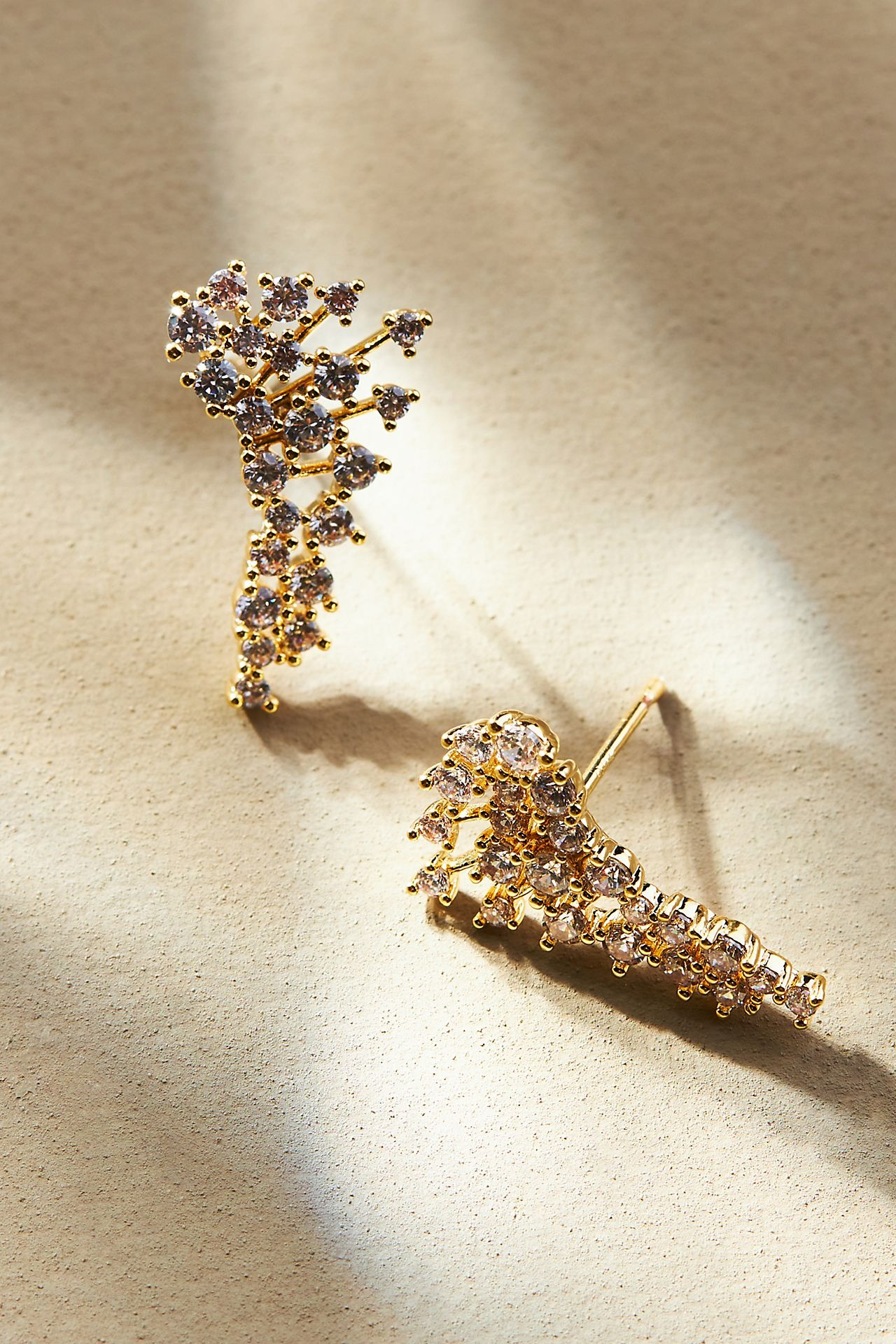 sparkling gold crawler earrings with rounded pearl shaped prongs