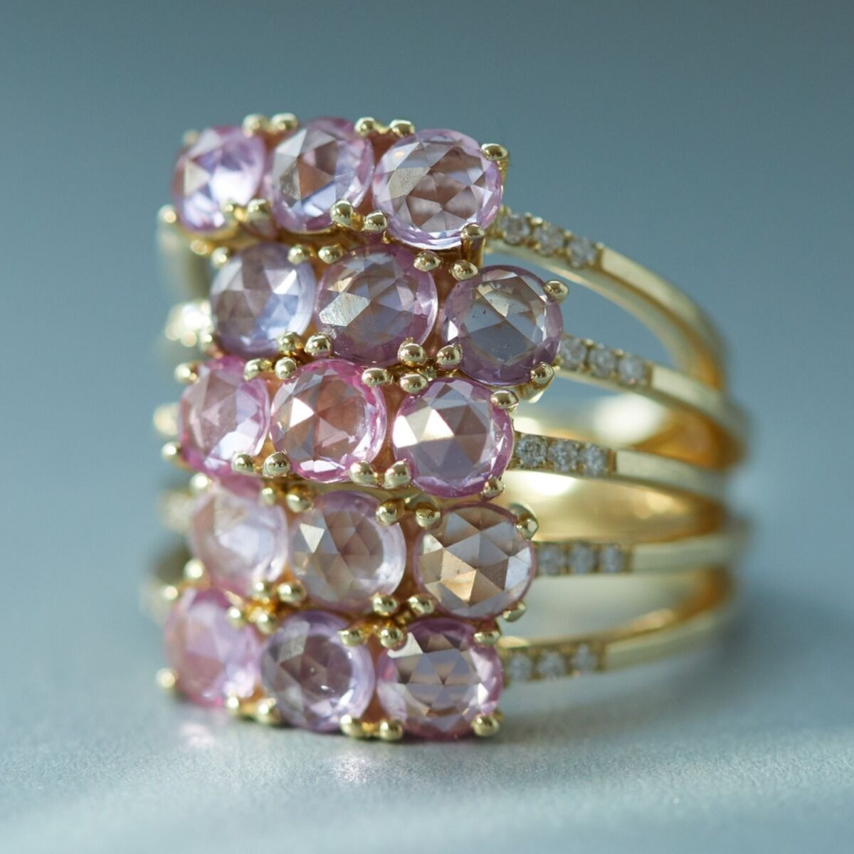 stack of pink sapphire engagement rings