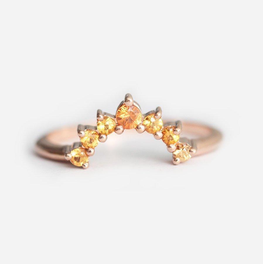 orange yellow sapphire rose gold band that looks like the sunrise