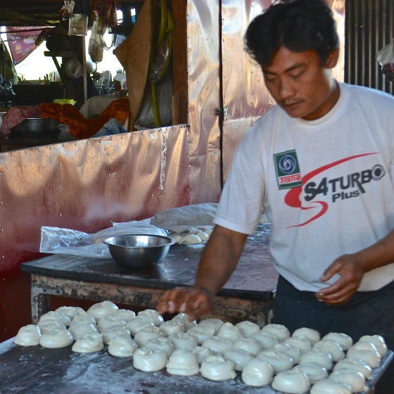 Preparing buns at the marketplace in Burma.