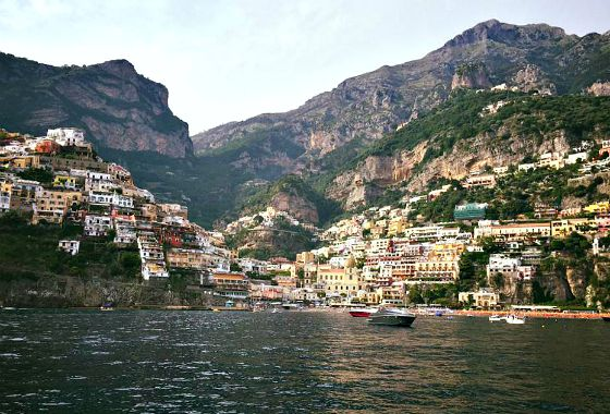 the view of Positano, Italy from the water