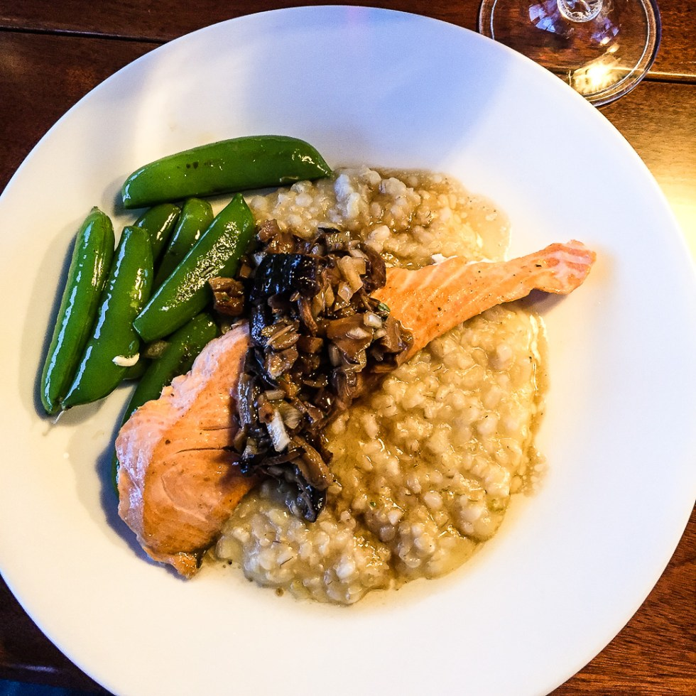 Silver back salmon with mushroom risotto and snap peas.