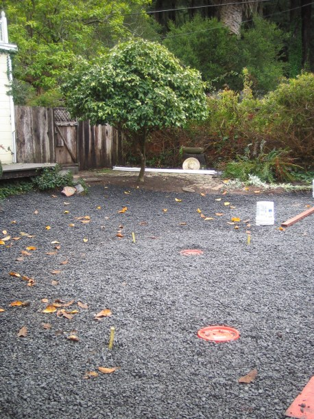BEFORE (the lawn has been removed and base rock installed.)
