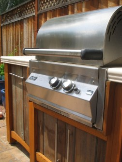 The wooden surround for the barbecue was created entirely by the homeowner.
