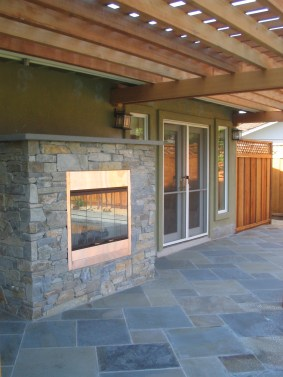 The homeowner did not have a fireplace inside, so an outside fire feature was high on her list.
