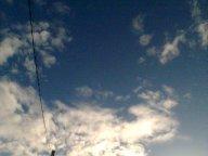 wispy clouds in sky