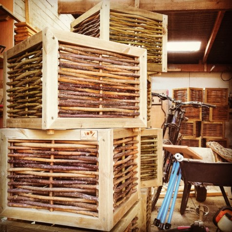 Willow boxes stacked in the workshop