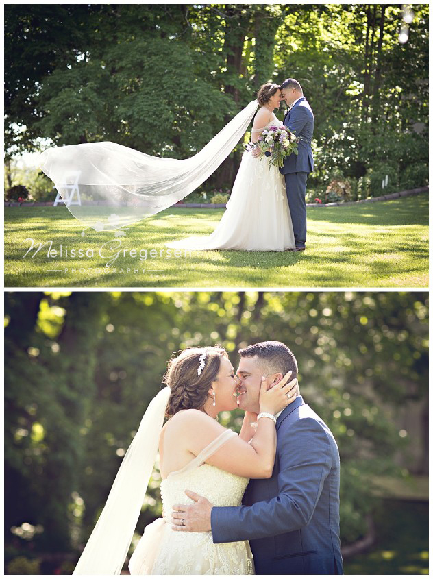 Smiles and kiss from the bride and groom at their Vintage Rose Barn Wedding
