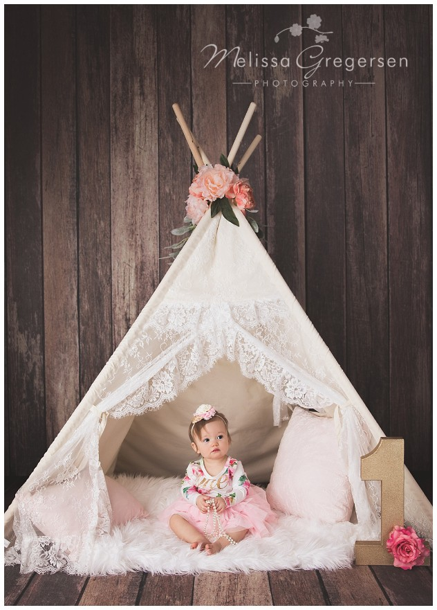 One year old baby girl with lace teepee for photography session at Gregersen Photography Studio
