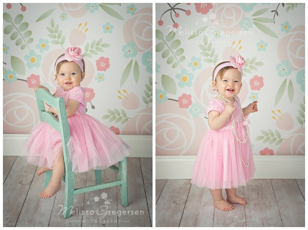 One year old baby girl dressed in pink dress and pearls for one year old photography session at Gregersen Photography