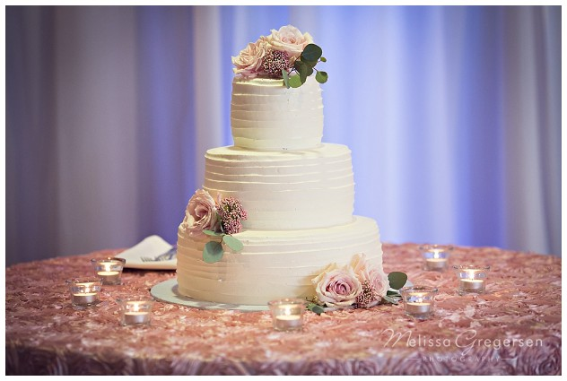 Wedding cake was the perfection of simplicity.
