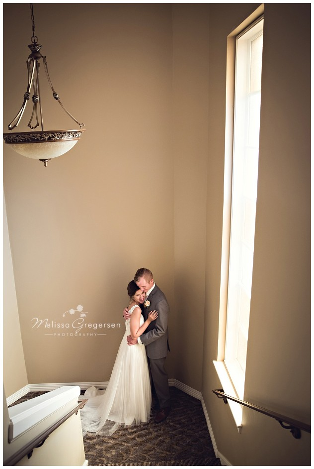 The church had a beautiful stairway for this portrait of the bride and groom.