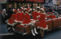 A group of women in santa costumes ride through the streets of New York in a red convertible, 1969. (Photo by Ernst Haas/Hulton Archive/Getty Images)