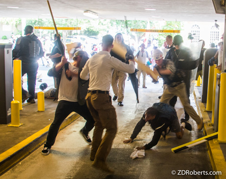 A group of neo-Nazis attack DeAndre Harris.
