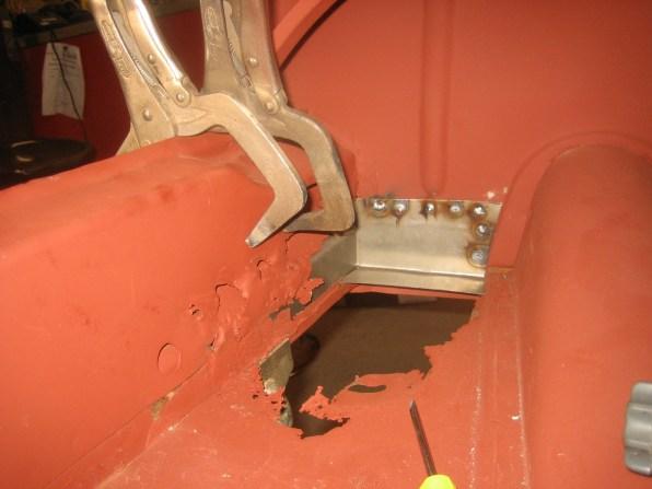 Inside trunk, left mount to frame