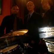 Greg performed with the Phil Ravita Band featuring vocalist Diane Hoffman (not pictured) at Germano's Trattoria in 2011. (left to right; Nucleo Vega [drums], Greg Small [piano], Phil Ravita [bass])