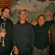 Greg joined the Phil Ravita jazz group in 2011 to perform a show at Germano's Trattoria featuring music from 1959, one of the most consequential years in jazz history. (left to right; Brent Madsen [trumpet], Greg Small [piano], Nucleo Vega [drums], Phil Ravita [bass]