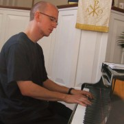 Greg at the piano, warming up before a 2013 performance at Babcock Presbyterian Church with trumpeter Chris Gekker.
