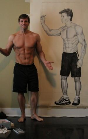 Greg Stevens posing with self-portrait