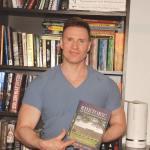 Greg Stevens shows off a new book.