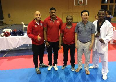 President Ji Ho Choi of the Pan-American Taekwon-do Union and other coaches
