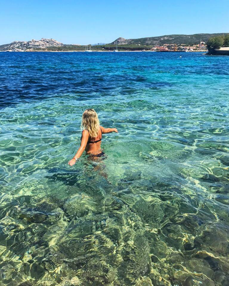 Swimming in the crystal clear waters of Sardinia