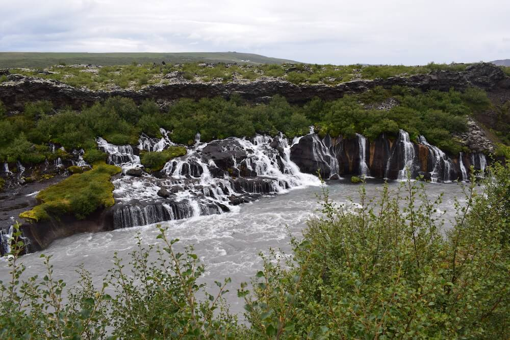 The Barnafoss falls, trickling in the river from within the lava field