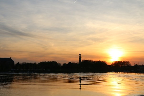 The church spire silhouetted against the sunset as we sail away from Veere