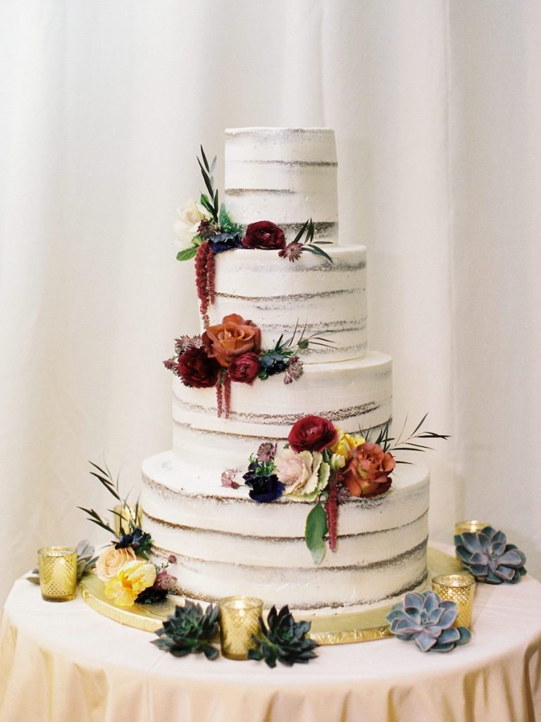 wedding stacked cake with flowers