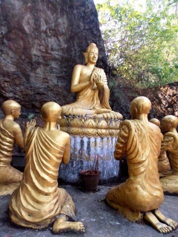 Statue of monks praying to buddha