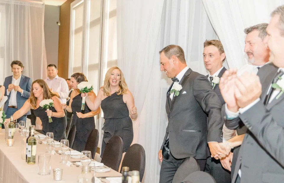 Gran Entrance sitting at Head Table - Bride and Groom Natural Posing - Having Fun with Bridesmaids - Black Bridesmaids Dresses for Curves - Holy Spirit Catholic Church Stittsville - Bride with Bridesmaids - Black and White Theme Wedding - Romantic Wedding at NeXt in Stittsville - Grey Loft Studio - Ottawa Wedding Photographer - Ottawa Wedding Photo & Video Team
