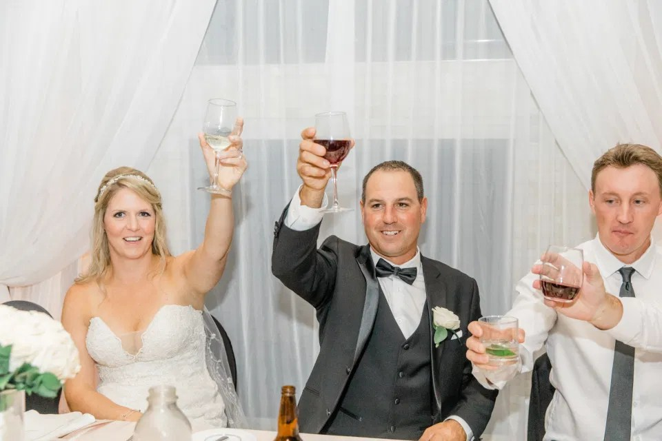 Reception Photos at NeXt in Stittsville - Bride and Groom Natural Posing - Having Fun with Bridesmaids - Black Bridesmaids Dresses for Curves - Holy Spirit Catholic Church Stittsville - Bride with Bridesmaids - Black and White Theme Wedding - Romantic Wedding at NeXt in Stittsville - Grey Loft Studio - Ottawa Wedding Photographer - Ottawa Wedding Photo & Video Team