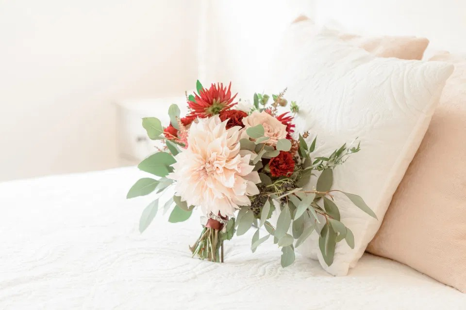Bride Bouquet on Bed Photo - Dahlia and Eucalyptus Florals - Fall Wedding Inspiration - Amy &. Nick | Le Belvedere at Wakefield in Quebec - Ottawa Wedding Venue - Grey Loft Studio