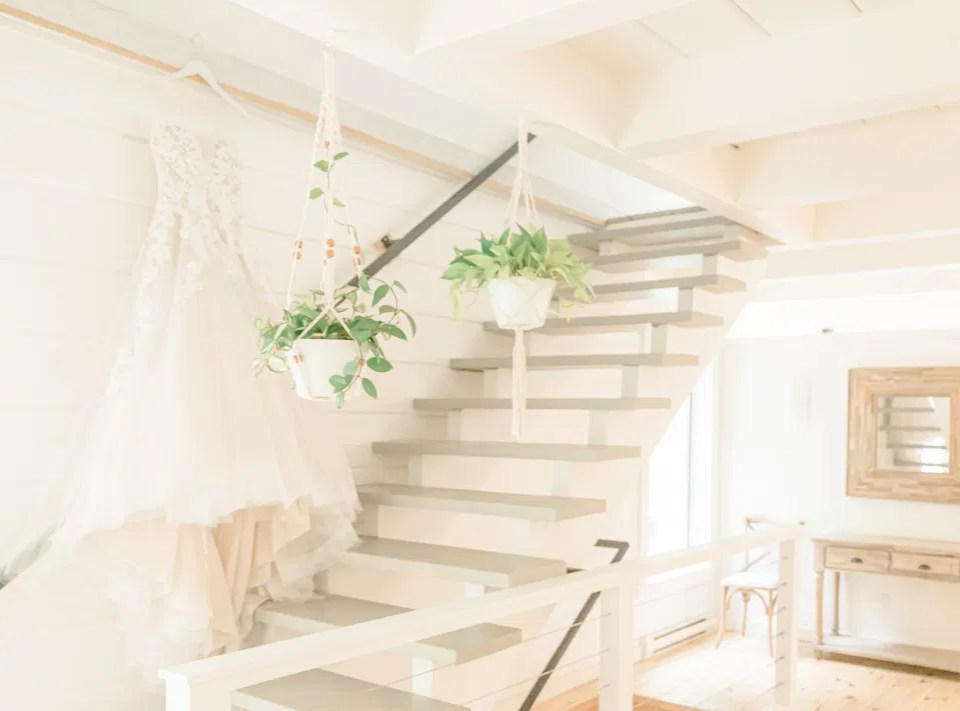 Wedding Dress Hanging in the Garden House - Le Belvedere - Wakefield Quebec - Photographer Bethany Barrette - Styling Details on Wedding Day - Grey Loft Studio -Amy &. Nick | Le Belvedere at Wakefield in Quebec - Ottawa Wedding Venue - Grey Loft Studio