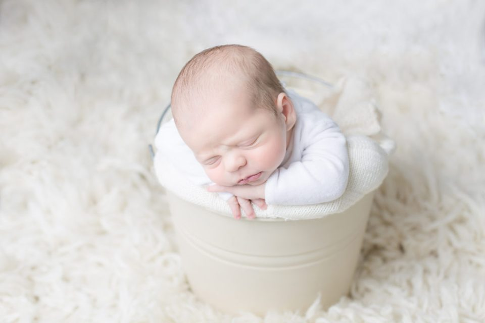 newborn baby photo of baby in a bucket white and organic wool