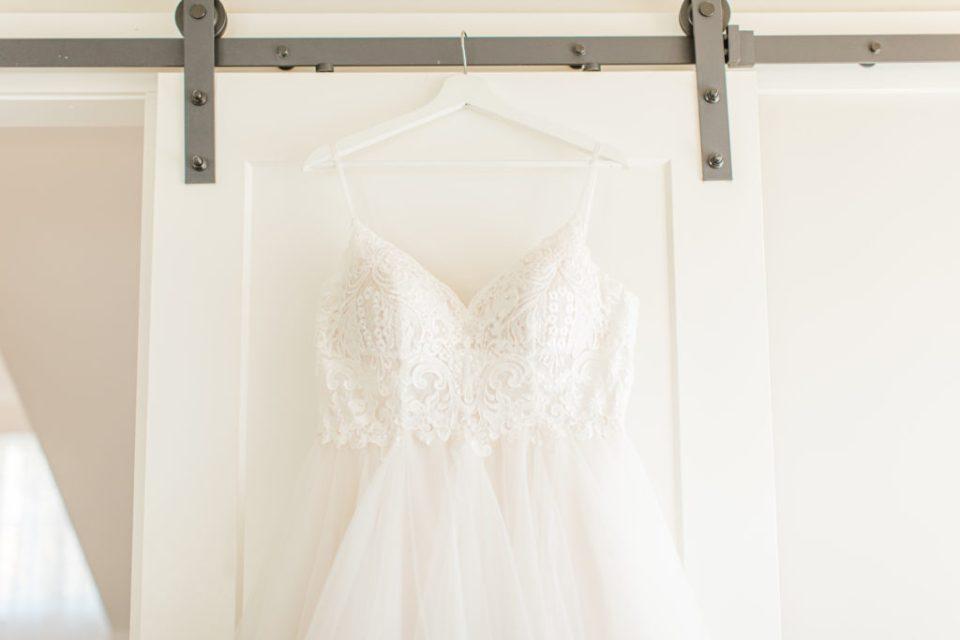 Wedding Dress Hanging - Stonefields Weddings and Events Interior - Ottawa Wedding Venue - Modern & Rustic Wedding Venue