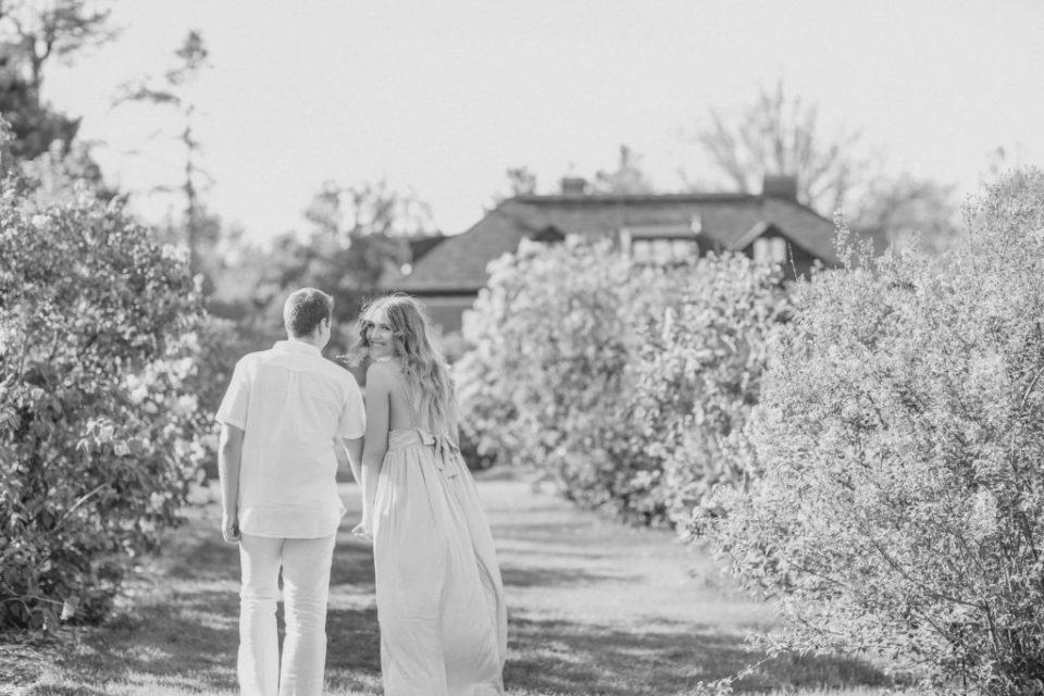 couple walking during an engagement session having fun in the Ornamental gardens ottawa Best Tips