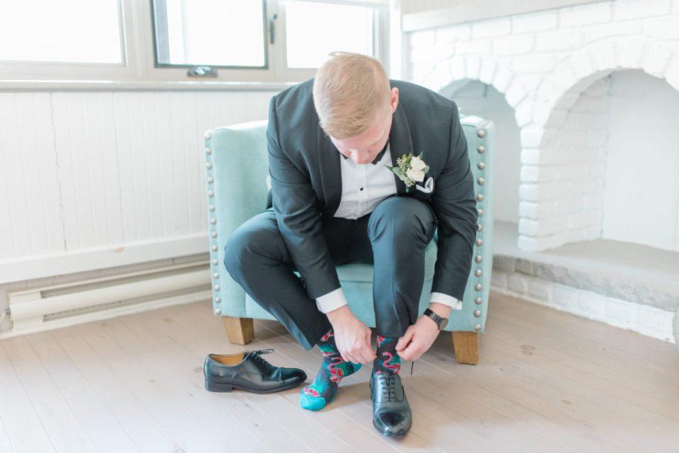 Groom Tying up shoes with Fun Socks - Wedding Day Groom Prep