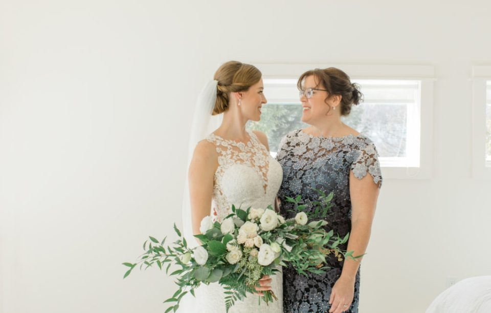 Bride with Mother Photos - Before She says I do - Cuddles with Mom- Her special day too.  Large Wedding Bouquet - White with Greenery - Lace Wedding Dress - Eucalyptus Seeds - Spray Roses - Luscious Bouquet