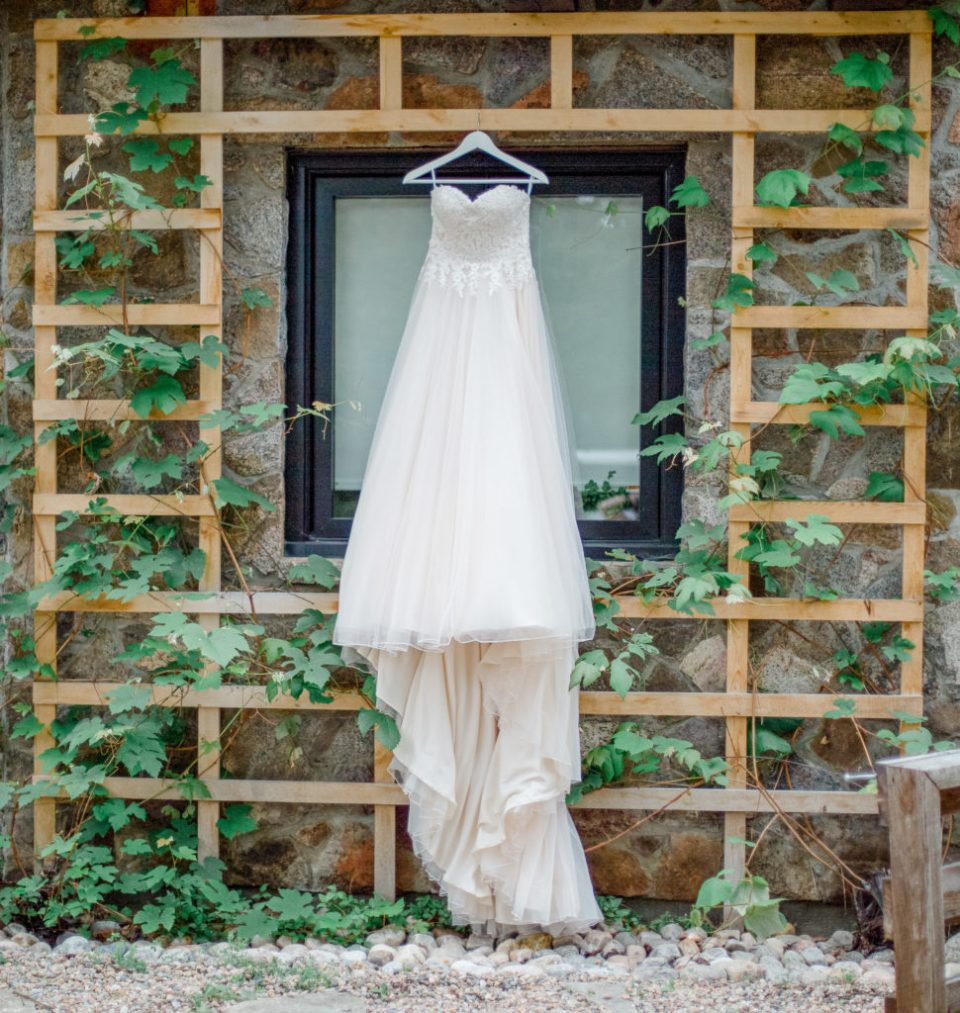 Wedding Dress hanging outside of Getting Ready Space - Grey Loft Studio - Ottawa Photographer