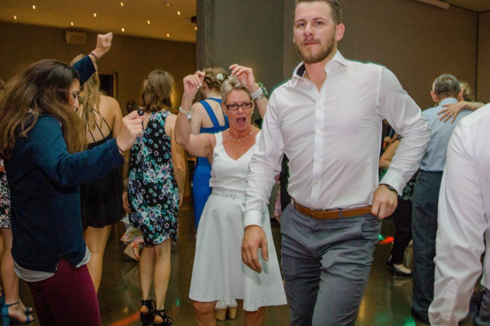 Mom and Groomsmen dancing and Having Fun at a Wedding - Lavender Rain Inspired Wedding - Le Belvedere- Grey Loft Studio- Ottawa Wedding Photographer - Affordable - Cheap - Fine Art - Best - Kanata Photographer - Wedding Videographer Ottawa - Light and Airy - Beautiful - Timeless - Organic Photographer Carp - Stittsville