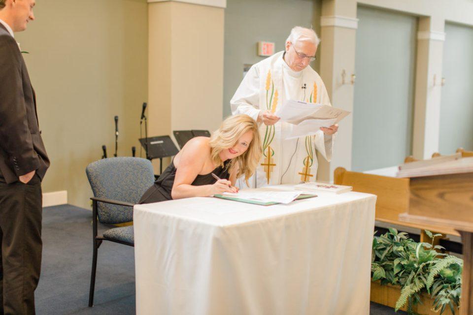 Witness Signing - Wedding Holy Spirit Catholic Church Stittsville - Bride with Bridesmaids - Black and White Theme Wedding - Romantic Wedding at NeXt in Stittsville - Grey Loft Studio - Ottawa Wedding Photographer - Ottawa Wedding Photo & Video Team