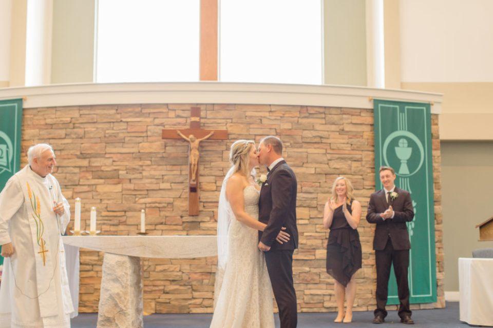 First Kiss Photo in Holy Spirit Catholic Church - Holy Spirit Catholic Church Stittsville - Bride with Bridesmaids - Black and White Theme Wedding - Romantic Wedding at NeXt in Stittsville - Grey Loft Studio - Ottawa Wedding Photographer - Ottawa Wedding Photo & Video Team
