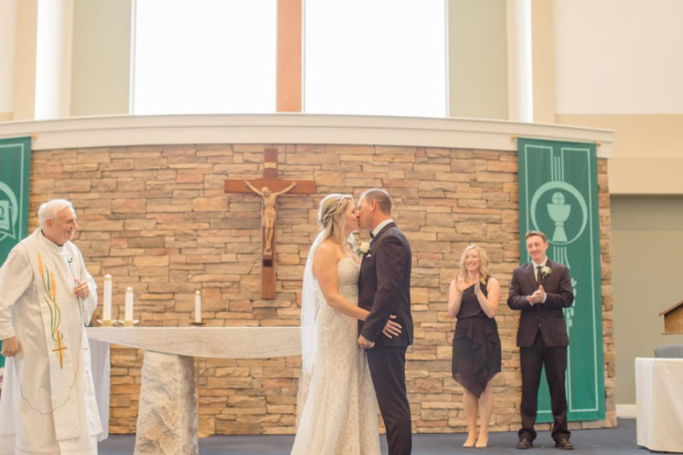 First Kiss Photo in Holy Spirit Catholic Church - Holy Spirit Catholic Church Stittsville - Bride with Bridesmaids - Black and White Theme Wedding - Romantic Wedding at NeXt in Stittsville - Grey Loft Studio - Ottawa Wedding Photographer - Ottawa Wedding Photo & Video Team