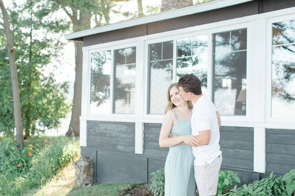 Ideas for what to wear for Engagement Photography, Modern Engagement Session Inspiration Wardrobe Ideas. Cottage Engagement Session. Unsure of what to wear for your engagement photos, we've got you! Romantic blue Romper and neutral Shirts and polo. Boat Shoes and Flip Flops. Engagement in Gananoque. Grey Loft Studio is Ottawa's Wedding and Engagement Photographer Videographer for Real couples, showcasing photos that are modern, bright, and fun.