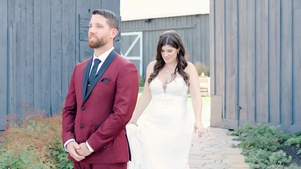 First Look Photo - Beautiful Landscapes with beautiful Ceremony Decor -Floral inspiration - Outdoor Ceremony With Wooden Modern Brown Wood Chairs. Interlock, beautiful Landscapes at Evermore Weddings and Events, Almonte Ontario - Grey Loft Studio